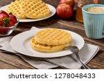 waffles and jam on breakfast... | Shutterstock . vector #1278048433