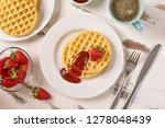 waffles and jam on breakfast... | Shutterstock . vector #1278048439