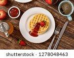 waffles and jam on breakfast... | Shutterstock . vector #1278048463