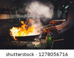 chef is stirring vegetables in...   Shutterstock . vector #1278056716