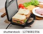 sandwiches in a panini press | Shutterstock . vector #1278081556