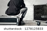 the man is sitting on the box | Shutterstock . vector #1278125833