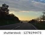 driving in a sunny autumn...   Shutterstock . vector #1278194473