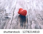 two pink heart on wooden table... | Shutterstock . vector #1278214810
