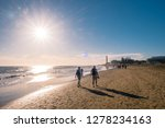 couple walking at the beach of... | Shutterstock . vector #1278234163