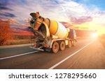 Blue Concrete Mixer Truck On...