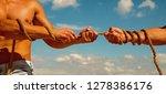 pulling hard. tug war is a...   Shutterstock . vector #1278386176