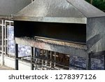 a large long iron stove brazier ... | Shutterstock . vector #1278397126