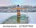 Woman Stands In The Ice Hole ...