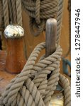 Canada, British Columbia, Victoria. Rigging rope wrapped around a wooden peg on the USCG Eagle is a three-masted sailing back ported at the Coast Guard Academy in New London, Connecticut