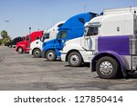 multiple trucks park in a large ... | Shutterstock . vector #127850414