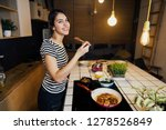 young smiling woman tasting a... | Shutterstock . vector #1278526849