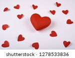 red hearts from paper on a... | Shutterstock . vector #1278533836