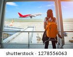 woman passenger of the airplane ... | Shutterstock . vector #1278556063