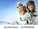 Cheerful Snowboarder Holding...