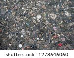 Surface Of A Polluted River In...