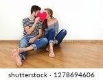 happy valentines couple sitting ... | Shutterstock . vector #1278694606