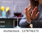 woman refuses to drink a... | Shutterstock . vector #1278746173