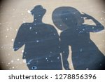shadow of two tourists on the... | Shutterstock . vector #1278856396