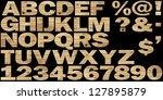 wooden alphabet on a black...   Shutterstock . vector #127895879