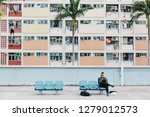 Man Relax On Bench At Colorful...