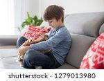 cute little boy feeding rabbits ... | Shutterstock . vector #1279013980