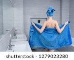 Young Girl In A Blue Towel In...