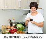portrait of glad mature woman... | Shutterstock . vector #1279033930