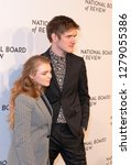 Small photo of New York, NY - January 8, 2019: Elsie Fisher wearing dress by Dorothee Schumacher and Bo Burnham attend National Board of Review 2019 Gala at Cipriani 42nd street