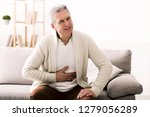 terrible stomachache. senior... | Shutterstock . vector #1279056289