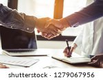 Two businessmen handshaking in meeting after final project agreement deal done. - stock photo