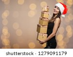 woman wearing a santa hat... | Shutterstock . vector #1279091179