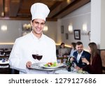smiling male chef with serving... | Shutterstock . vector #1279127686