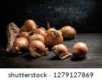raw onions lay on a gray table  ... | Shutterstock . vector #1279127869