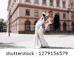 groom holds bride tender in his ... | Shutterstock . vector #1279156579
