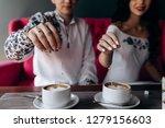 bride and groom throw sugar in... | Shutterstock . vector #1279156603