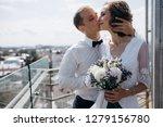 groom holds bride tender... | Shutterstock . vector #1279156780