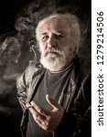 grumpy senior man smoking... | Shutterstock . vector #1279214506