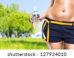 fit woman in nature in spring | Shutterstock . vector #127924010