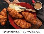 fresh croissants with butter... | Shutterstock . vector #1279263733