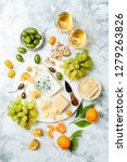 cheese platter with different... | Shutterstock . vector #1279263826