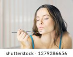 young woman eating delicious... | Shutterstock . vector #1279286656