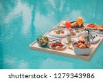 breakfast in swimming pool ... | Shutterstock . vector #1279343986