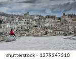 matera is an atmospheric cave... | Shutterstock . vector #1279347310