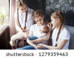 newborn baby with  sisters.... | Shutterstock . vector #1279359463