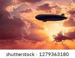 Flying Airship At Sunrise