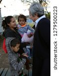 Small photo of McAllen, TX/U.S. - Dec. 12, 2018: Sister Norma Pimental, director of the Catholic Charities' Humanitarian Respite Center, speaks with a young Central American woman seeking asylum and her family.