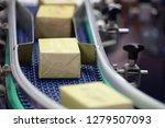 pakage moving on conveyor belt... | Shutterstock . vector #1279507093