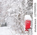 Red Postbox Covered With White...