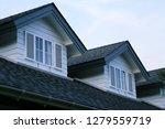 Small photo of House garret closeup blur sky background